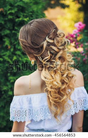 Curly hairstyle from back view