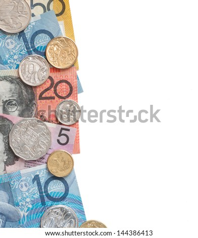 Currency of Australia in notes and coins arranged as a border and isolated on white