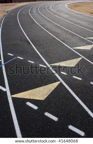 Curve of a black running track with reflective surface