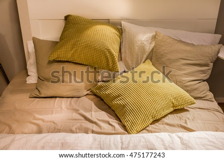 cushion and pillow on bed, cozy bedroom