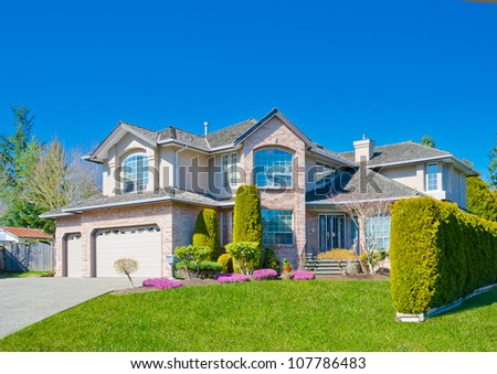 Custom built big luxury house in a residential neighborhood. Suburbs of Vancouver ( Surrey ) Canada.