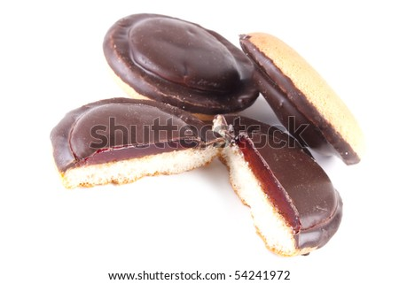 Cut chocolate cookie with filling on a white background