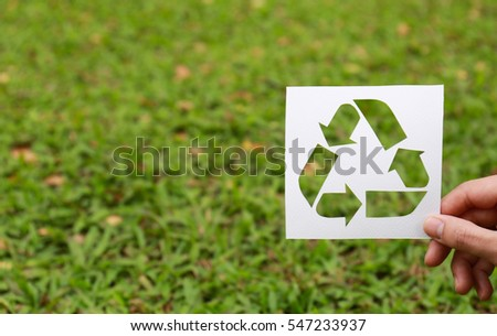 Cut paper with the logo of recycling
