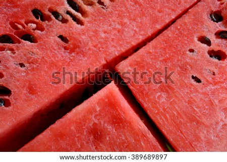 Cut watermelon with seeds closeup