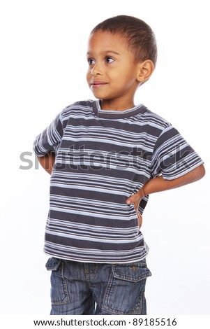 cute african american boy posing over white