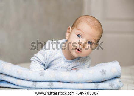 Cute and adorable newborn baby trying to crawl