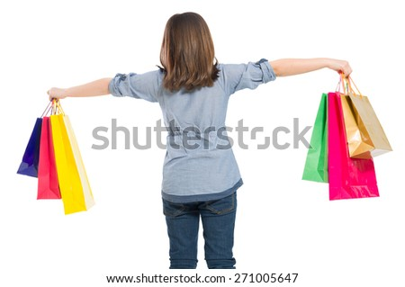 Cute and young shopping girl from behind isolated on white background
