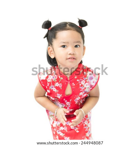 Cute asian girl in red chinese dress isolated on the white background