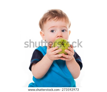 Cute baby boy kid eating and playing with green apples isolated on white background