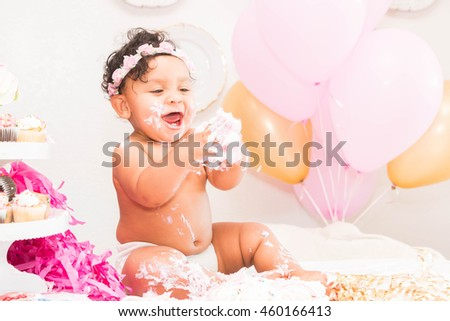 Cute Baby Girl Sitting With Cake and Balloons