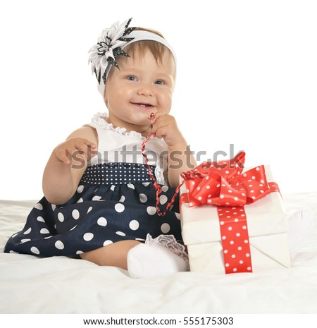 Cute baby girl with gift