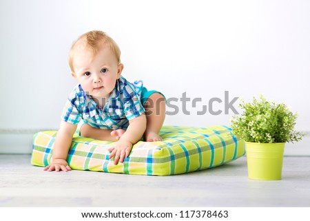 Cute baby sitting on the floor