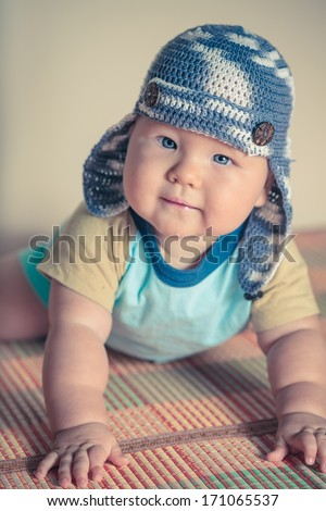 Cute beautiful baby is wearing a funny hat