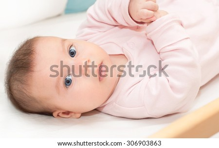 Cute blue-eyed newborn baby