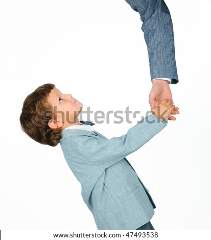Cute boy in a suit shaking hands