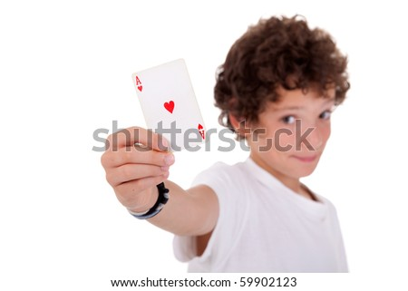cute boy showing an ace of hearts, isolated on white, studio shot