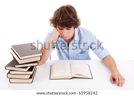 cute boy studying and reading a book on his desk, isolated on white, studio shot
