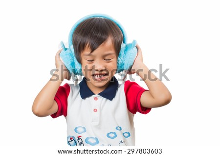 Cute boy wearing headphones and enjoying music,Isolated