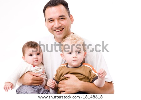 Cute brother and sister from different races having fun with daddy
