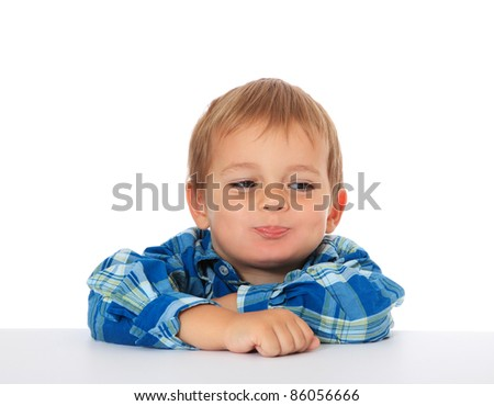 Cute caucasian boy fooling around. All on white background.