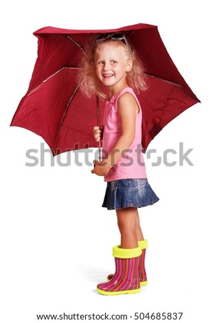 Cute cheerful little girl in a blouse, a skirt and rubber boots with an umbrella standing isolated on white background.