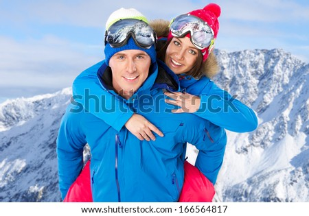 Cute couple wearing snowboard costumes