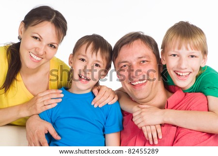 cute family of a four on white