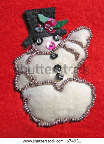 Cute felt snowman from antique Christmas stocking.