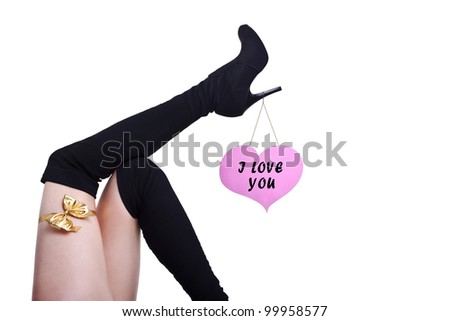 cute female legs with pink heart and yellow ribbon