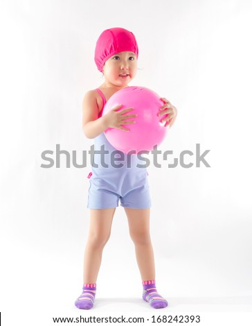 cute girl in swimming suit playing ball on white background.