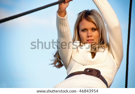 Cute girl on sailing boat, blue sky
