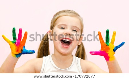 Cute happy little girl with hands in paint isolated