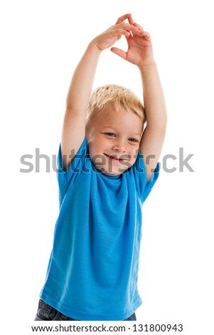 Cute happy 3 year old boy with arms raised overhead isolated on a white background