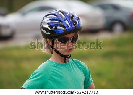 Cute kid with sunglasses and protect helmet outdoor