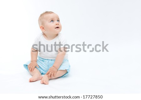 cute laughing baby boy sitting on white background