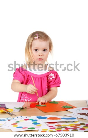 cute little baby making applique and drawing