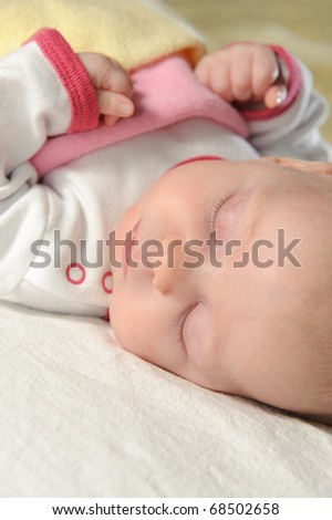 Cute little baby sleeping on white blanket