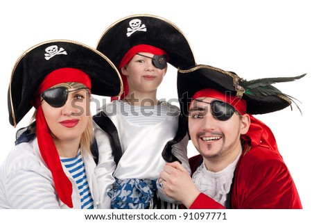 cute little boy and his parents in the pirate costumes