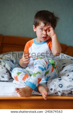 Cute little boy in pajamas on sunny morning