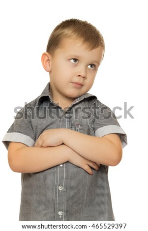 Cute little boy put his hands on his chest and looks away. Close-up - Isolated on white background