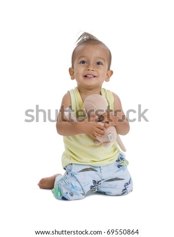 cute little boy with cuddly, isolated on white background