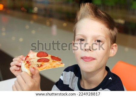 cute little boy with pizza