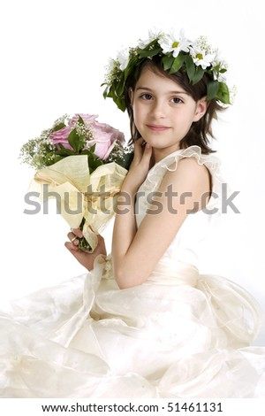 Cute little bridesmaid holding a bunch of roses