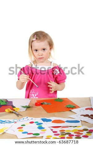 cute little child drawing and making applique
