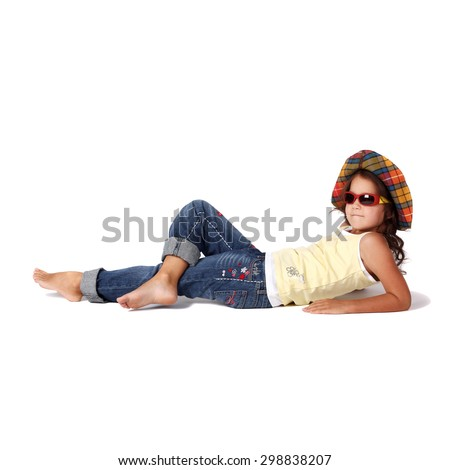 cute little girl in sunglasses and panama lying on the floor