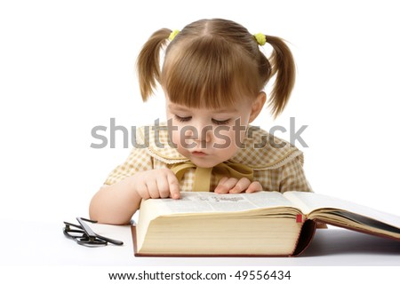 Cute little girl reading books, back to school, isolated over white