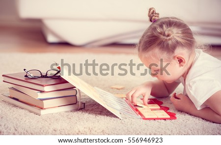 Cute little girl study mathematics at home
