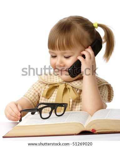 Cute little girl with book and a cell phone, back to school concept, isolated over white