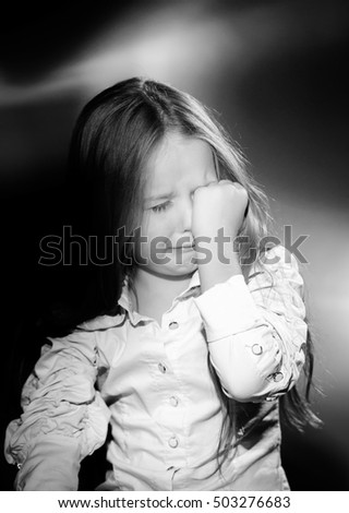 Cute little girl with long hair crying, black and white