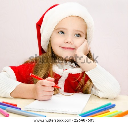 Cute little girl writes letter to Santa